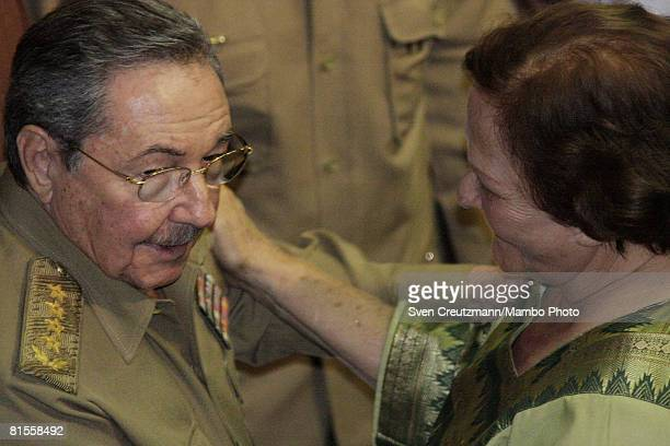 Cuba's President Raul Castro talks with Aleida March widow of Ernesto Che Guevara after a concert celebrating the 80th birthday of Che in the Karl...