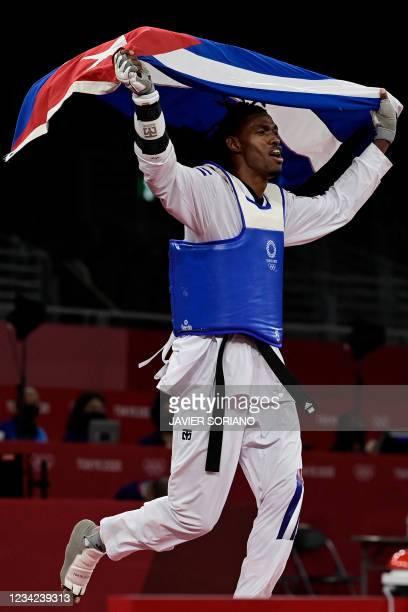 Cuba's Rafael Yunier Alba Castillo celebrates after winning the taekwondo men's +80kg bronze medal B bout during the Tokyo 2020 Olympic Games at the...