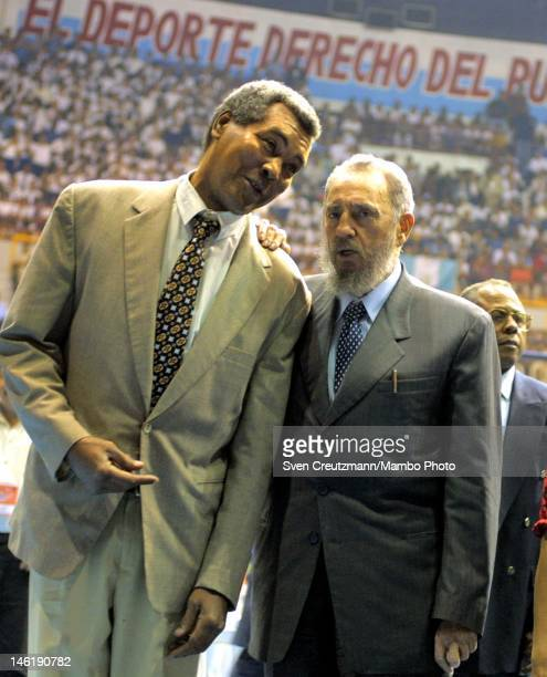 Cuba's Revolution leader Fidel Castro stands next to Cuba's boxing legend Teofilo Stevenson during the closing ceremony of the fist Cuban Olympic...