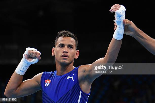 Cuba's Robeisy Ramirez celebrates winning against India's Shiva Thapa during the Men's Bantam match at the Rio 2016 Olympic Games at the Riocentro...
