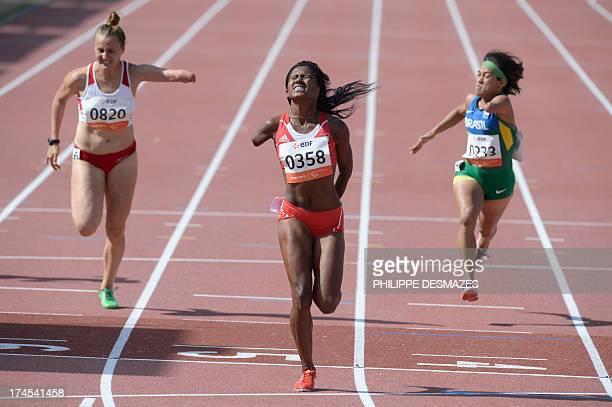Cuba's Yunidis Castillo crosses the finish line to win the Women's 100 m T46 final next to Poland's Alicja Fiodorow and Brazil's Teresinha Santos...