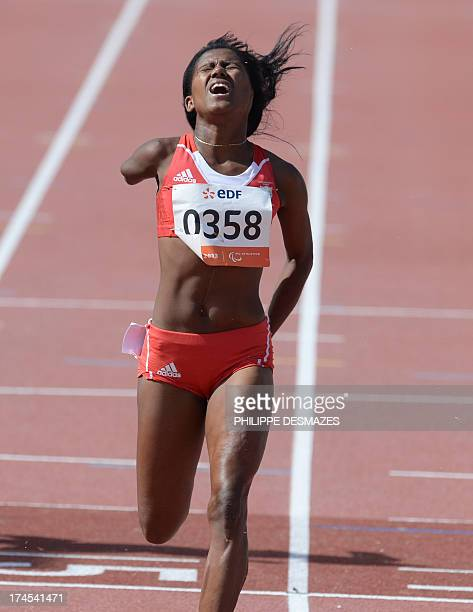 Cuba's Yunidis Castillo crosses the finish line to win the Women's 100 m T46 final on July 27 2013 during of the IPC Athletics World Championships at...