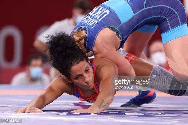 Cuba's Yusneylis Guzman Lopez wrestles Ukraine's Oksana Livach in their women's freestyle 50kg wrestling repechage match during the Tokyo 2020...