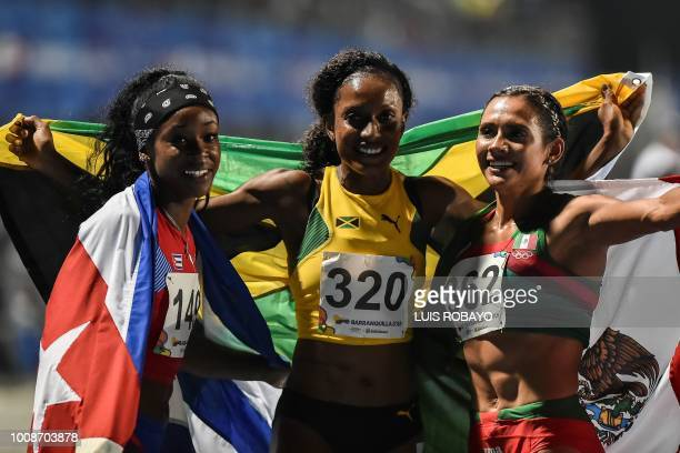 Cuba's Zurian Hechavarria Jamaica's Ronda Whyte and Mexico's Zudikey Rodriguez celebrate at the end of women's 400m hurdles final during the 2018...