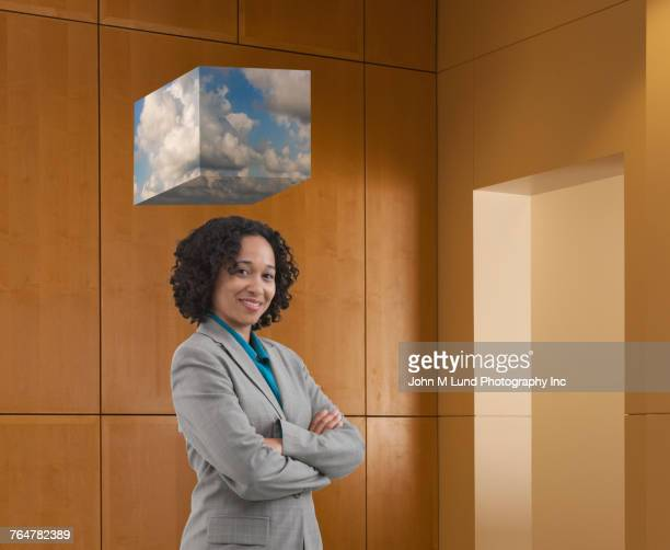 Cube of cloud computing over mixed race businesswoman