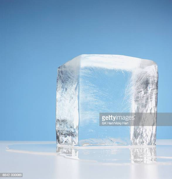 cube of melting ice - ice stock pictures, royalty-free photos & images