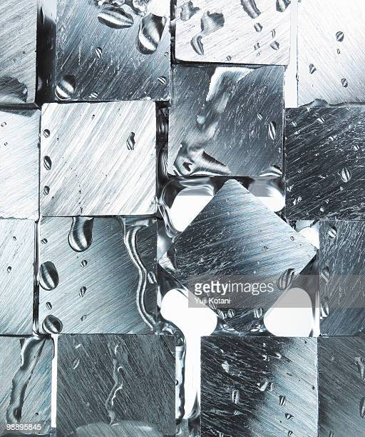 Cube of metal and splash water