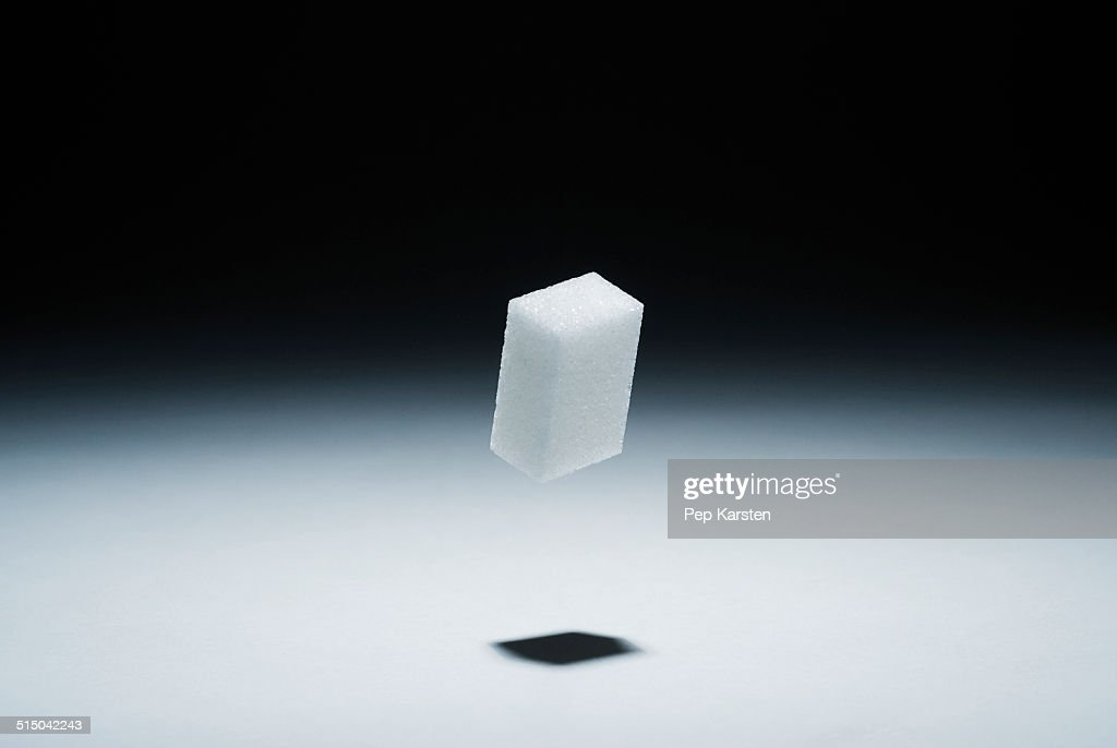A cube of sugar in mid-air : Stock Photo