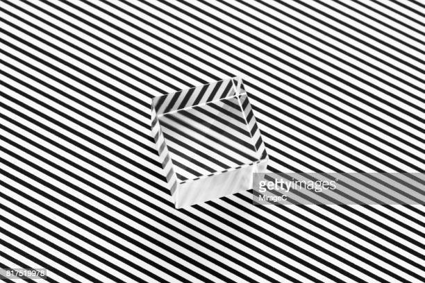 cube prism on black and white stripes illusion - optical illusion stock photos and pictures