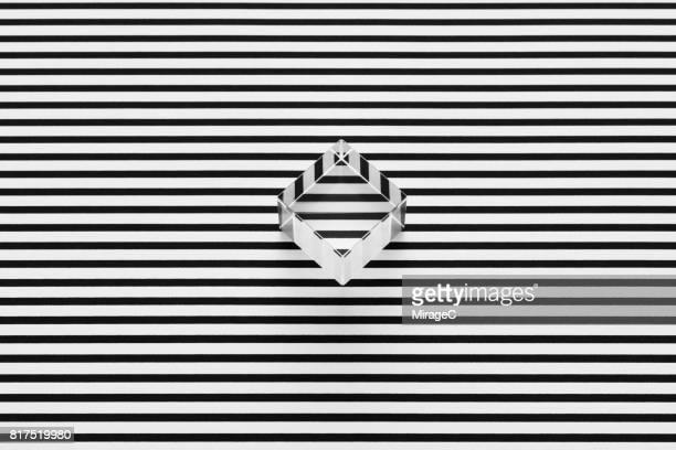 cube prism on black and white stripes illusion - geometria fotografías e imágenes de stock