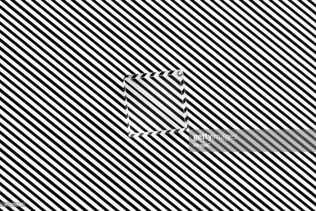 Cube Prism on Black and White Stripes Illusion : Stock Photo