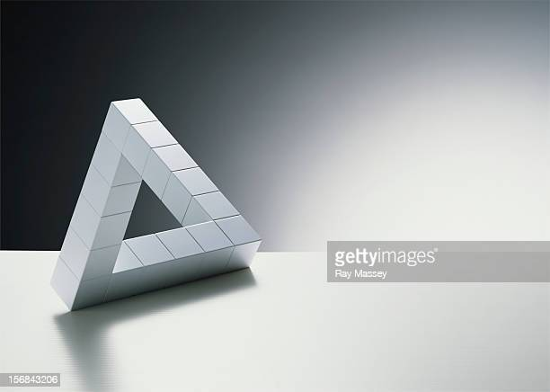 cubes forming triangle - optical illusion stock photos and pictures