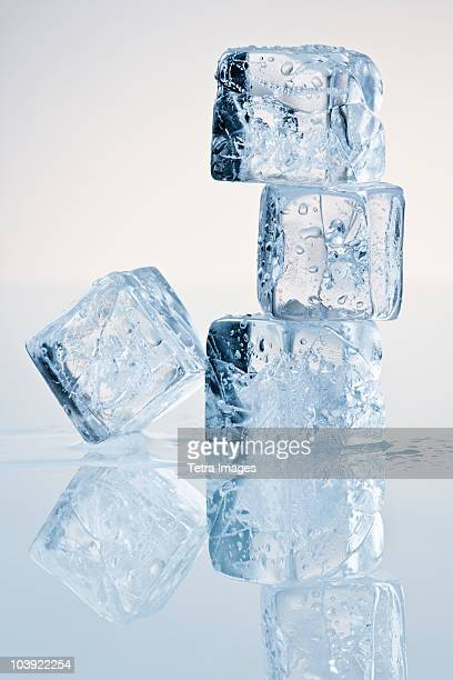 cubes of melting ice - ice cube stock photos and pictures