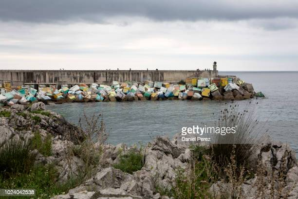 Cubes of memory painted by Agustin Ibarrola artist in the port pier on July 27, 2018 in Llanes, Spain.