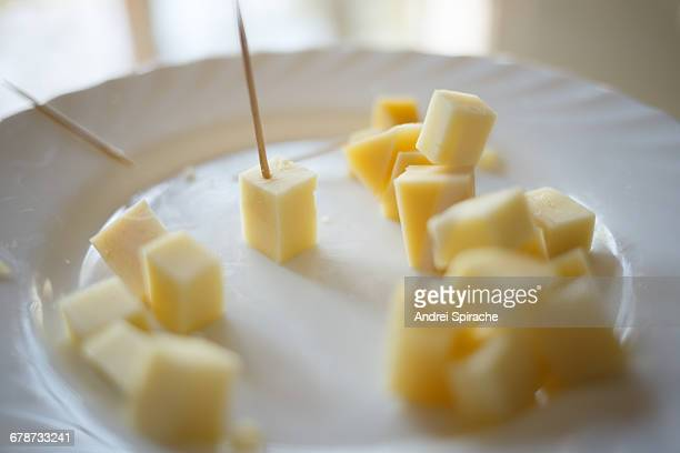 Cubes of yellow cheese