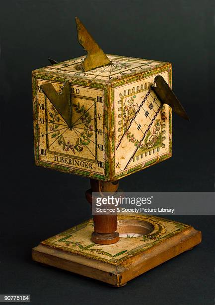 Cubical polyhedral sundial in wood with paper scales signed D Beringer Sundials were accurate enough timekeepers for most people in the 18th century...