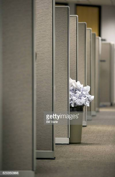 cubicles and overflowing trash - side by side stock pictures, royalty-free photos & images
