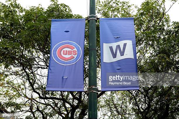 Cubs banner and 'W' banner hangs on Sheffield Avenue outside Wrigley Field home of the Chicago Cubs baseball team to celebrate the Cubs' World Series...