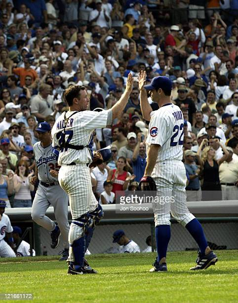 CubsÆ catcher Damian Miller congratulates Mark Prior after beating the Dodgers 21