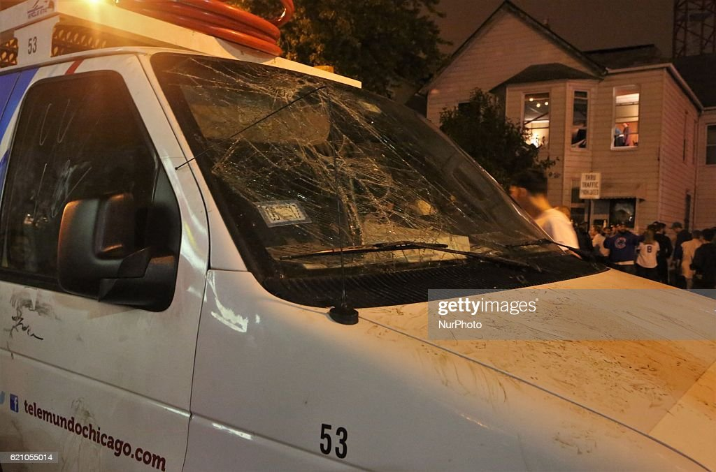 Cubs fans broke windows of a Telemundo satellite truck after the Cubs win the World Series at Wrigley Field in Chicago, Illinois, United States on November 2, 2016.