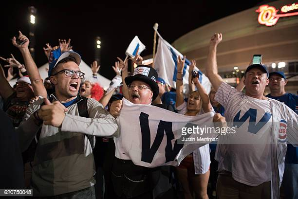 Cubs fans celebrate after the Chicago Cubs defeat the Cleveland Indians in game 7 of the World Series in the early morning hours on November 3 2016...