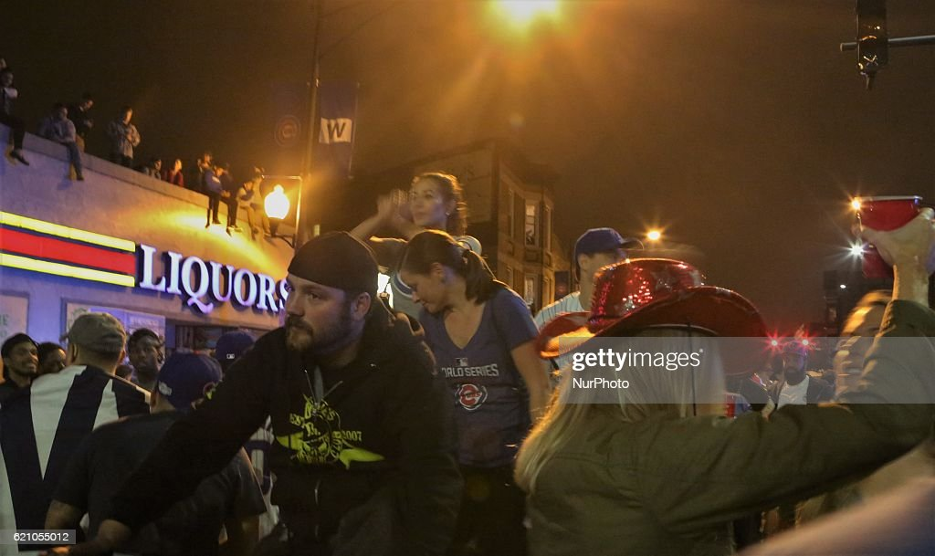 Cubs fans dance on a rickshaw after the Cubs win the World Series at Crown Liquors in Chicago, Illinois, United States on November 2, 2016.