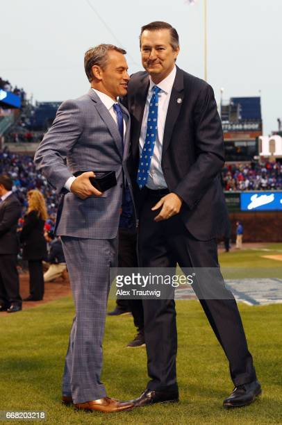 Cubs General Manager Jed Hoyer hugs owner Tom Ricketts during the World Series ring ceremony ahead of the game between the Los Angeles Dodgers and...