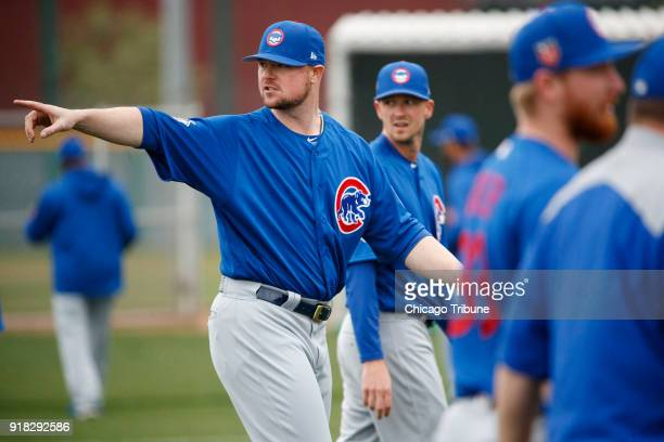 Cubs pitcher Jon Lester warms up during the first day of pitchers and catchers practice at Sloan Park during Cubs spring training Wednesday Feb 14 in...