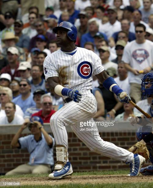 Cubs' Sammy Sosa RBI's in the first inning after hitting double.