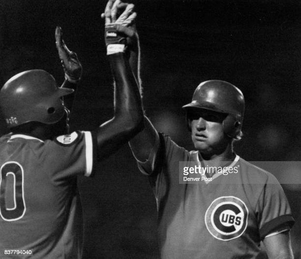 Cubs third baseman Fritz Connally right is greeted at home plate by teammate Joe Carter with a high five after Connally clubed a grand slam in the...
