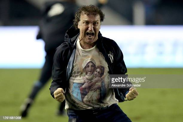 Cuca head coach of Santos celebrates the fourth goal of his team during a quarter final second leg match between Santos and Gremio as part of Copa...