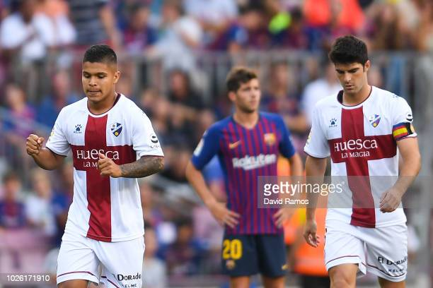Cucho Hernandez of SD Huesca celebrates after scoring the opening goal during the La Liga match between FC Barcelona and SD Huesca at Camp Nou on...