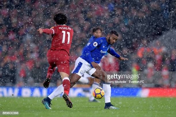 Cuco Martina of Everton and Mohamed Salah challenge for the ball during the Premier League match between Liverpool and Everton at Anfield on December...