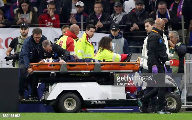 Cuco Martina of Everton is stretchered off injured during the UEFA Europa League group E match between Olympique Lyon and Everton FC at Stade de Lyon...