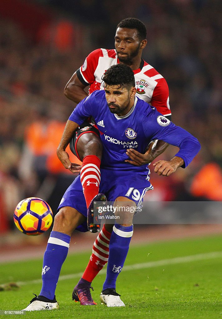 Cuco Martina of Southampton attempts to tackle Diego Costa of Chelsea during the Premier League match between Southampton and Chelsea at St Mary's Stadium on October 30, 2016 in Southampton, England.