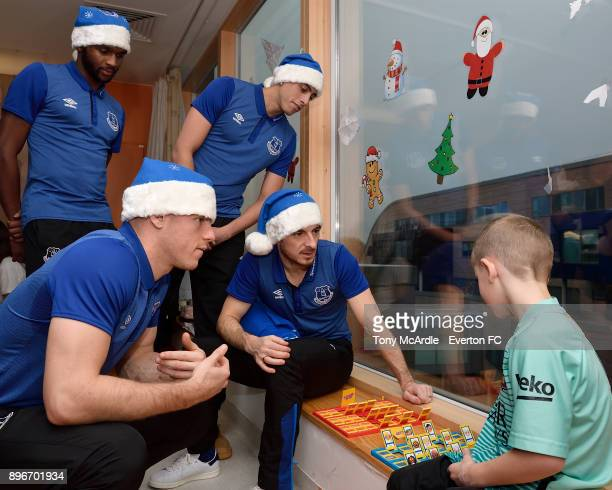 Cuco Martina Ross Barkley Ramiro Funes Mori and Leighton Baines during the visit of Everton players Christmas visit to Alder Hey Childrens Hospital...