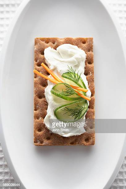 Cucumber and cream cheese snack on a plate