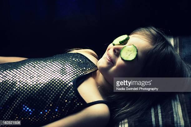 cucumber on eyes - weybridge stock photos and pictures
