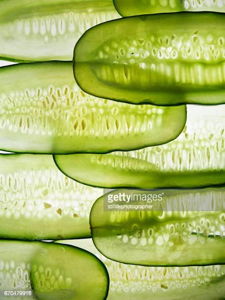 cucumber slices in line - cucumber stock pictures, royalty-free photos & images