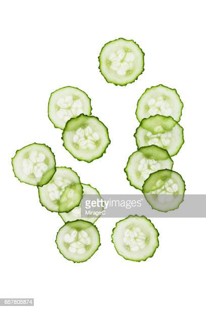 cucumber slices on white background - pepino fotografías e imágenes de stock