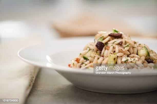 cucumber-dill orzo pasta salad - kalamata olive stock pictures, royalty-free photos & images