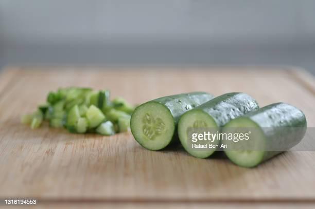 cucumbers on cutting board - rafael ben ari fotografías e imágenes de stock