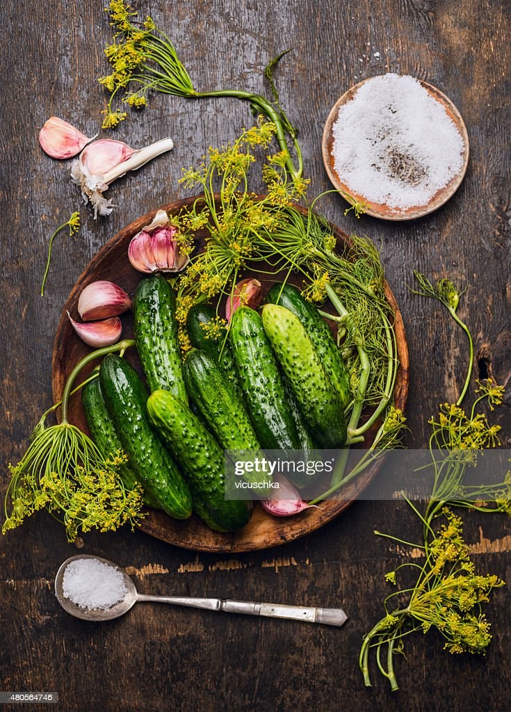 Cucumbers,herbs and spices for pickling on rustic background : Stock Photo