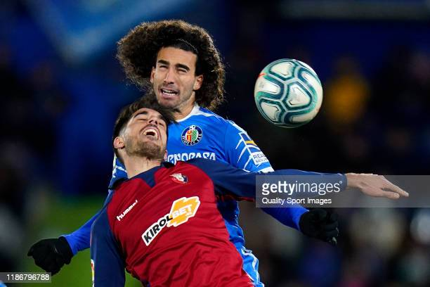 Cucurella of Getafe CF battle for the ball with Nacho Vidal of CA Osasuna during the Liga match between Getafe CF and CA Osasuna at Coliseum Alfonso...