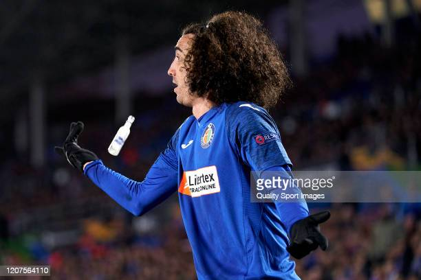 Cucurella of Getafe CF reacts as he is almost hit by a small bottle during the UEFA Europa League round of 32 first leg match between Getafe CF and...