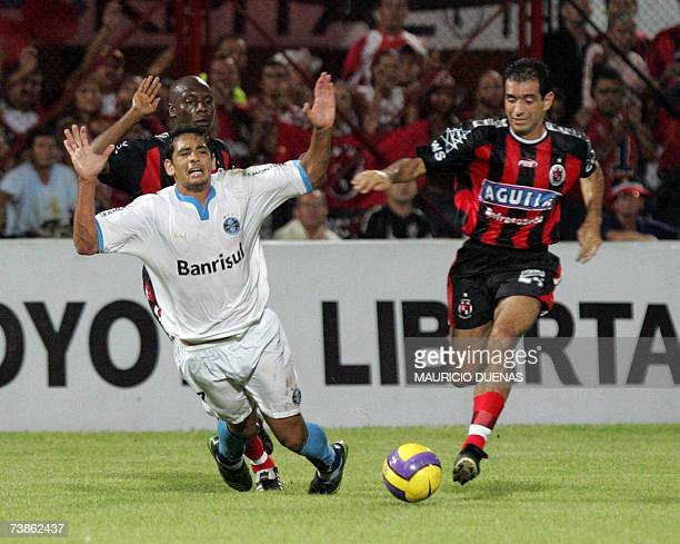 Diego Souza of Brasil's Gremio is fouled by Jose Castillo of Colombia's Cucuta Deportivo during their Libertadores Cup football match 11 April in...
