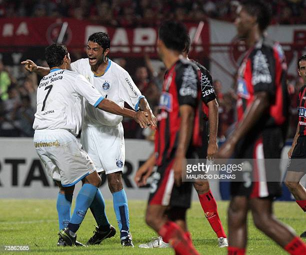 William and Diego Souza of Brasil's Gremio celebrate after scoring against Colombias Cucuta during their Libertadores Cup football match 11 April in...