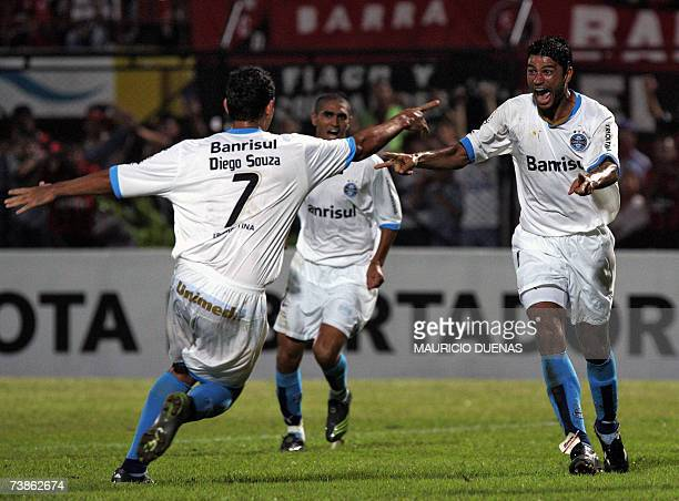 William and Diego Souza of Gremio of Brazil celebrate after scoring against Cucuta of Colombia during their Libertadores Cup football match 11 April...
