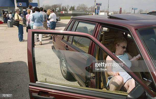 Cudahy Wisconsin resident Charlene Buckner sits in her car with her Big Game lottery picks as others wait in line to buy their Big Game lottery...