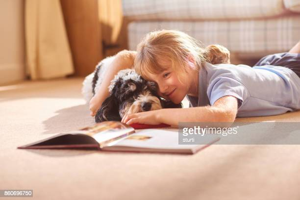 cudding her dog reading a book